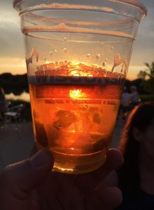 sunset in a plastic beer glass